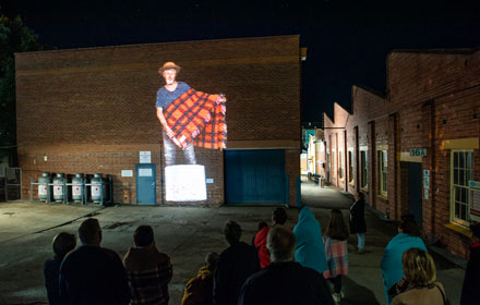 Image projected onto a brick wall.