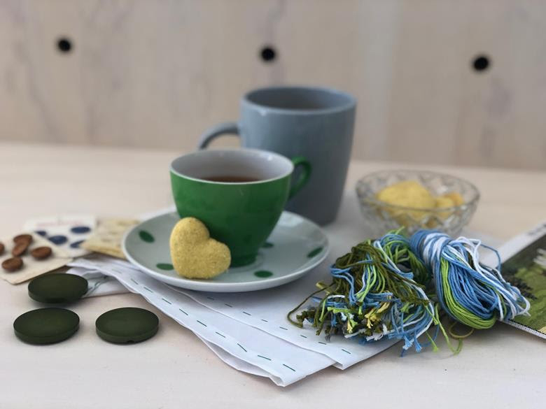 Cup of tea with art supplies.