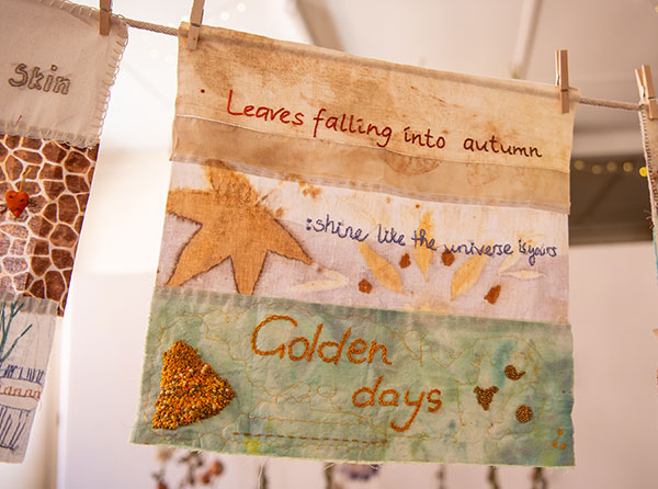 """textile art saying """"leaves falling into autumn"""", """"shine like the universe is yours"""", """"golden days"""""""