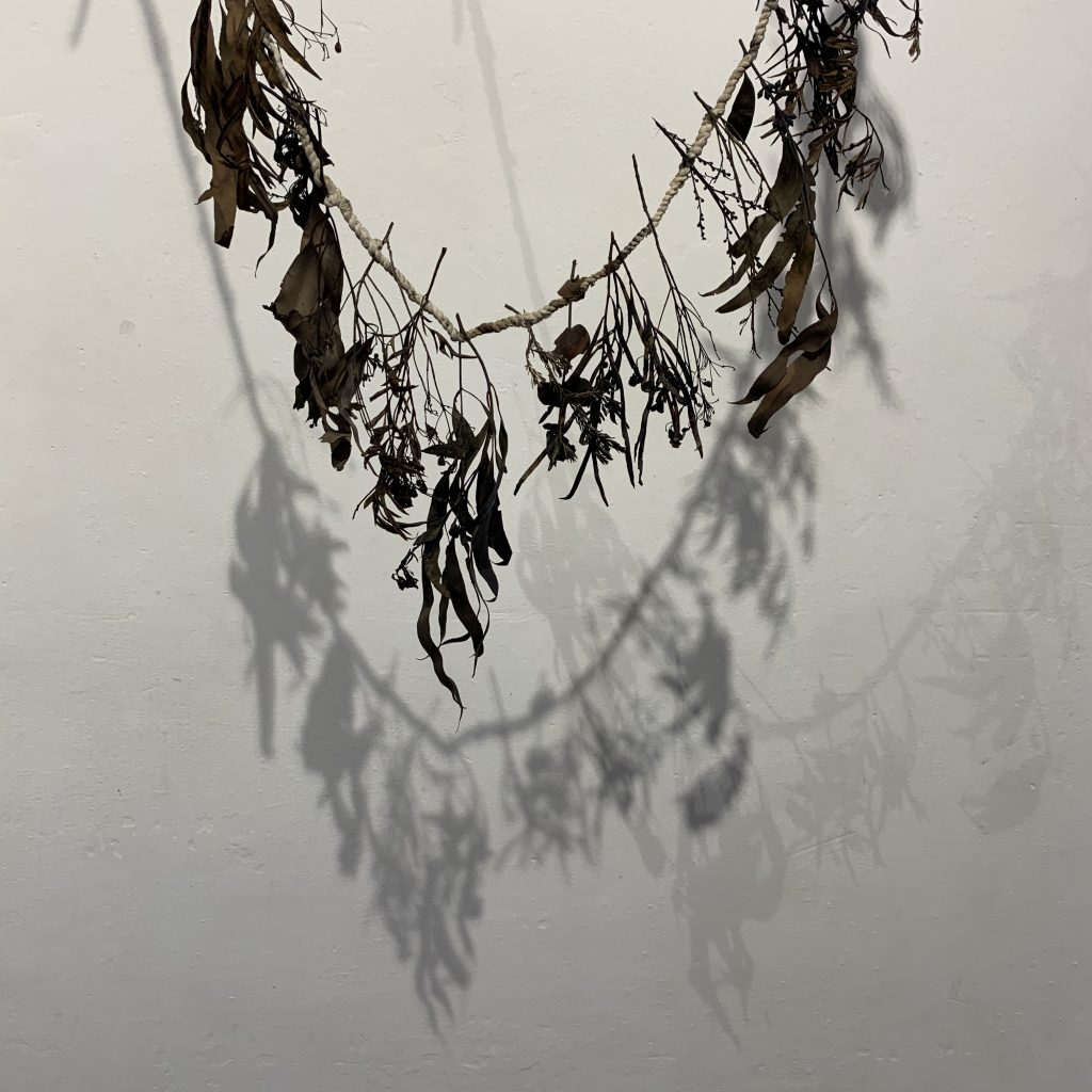 India Flint – in my dreams this garland is a tattered but powerful talisman made with sprigs from trees planted by my father entwined by cloth from a dress of my mother's, worked to keep those I hold dear safe from harm