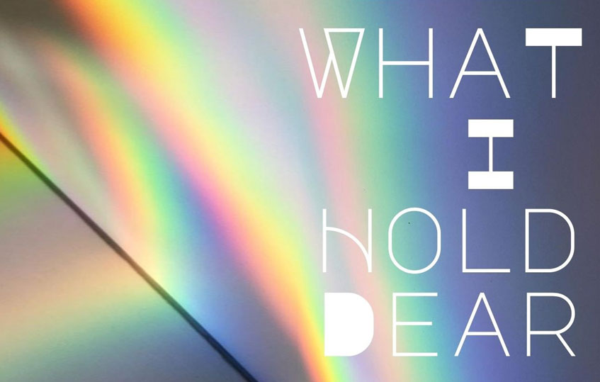 """Image with text. Image shows rainbow light. Text reads """"What I Hold Dear"""""""