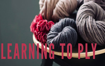 """Image with text. Text reads """"learning to ply"""" Image shows balls of wool."""