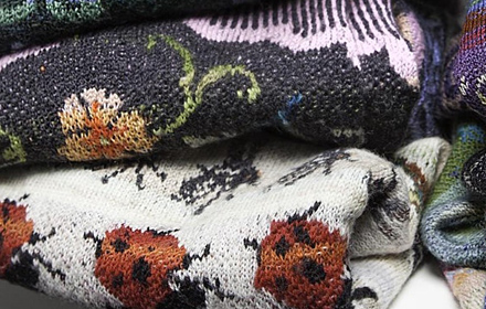 Close up of folded knitted woollen jumpers.