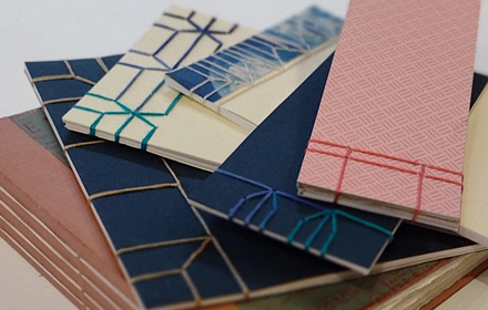 An image showing 6 beautifully bound books. The books are bound using different stitching methods and have different coloured threads and covers.